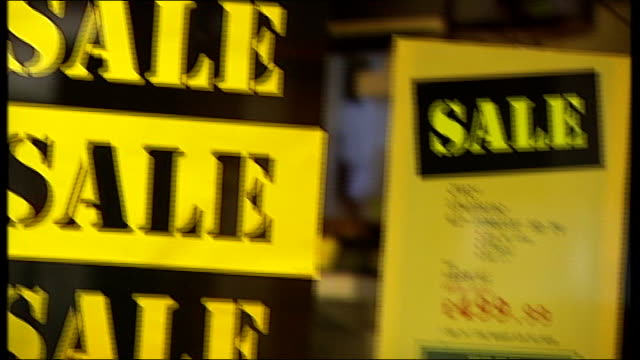 'double dip' recession fears: house prices and high street spending falls; date and location unknown: ext close shot of 'sale toshiba notebook' sign... - bericht film und fernsehen stock-videos und b-roll-filmmaterial