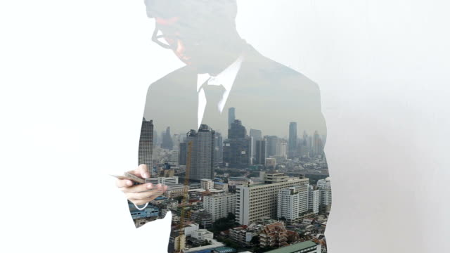Double exposure business man working with a mobile phone