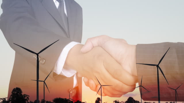 double exposure handshake after successful with wind energy turbine. industrial successful concept. - politician stock videos & royalty-free footage