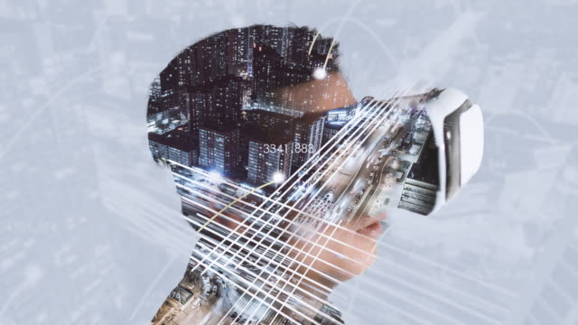 t/l zo double exposure of man using vr glasses and smart city - innovazione video stock e b–roll