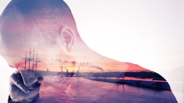 Double Exposure of Sunset and Young Man