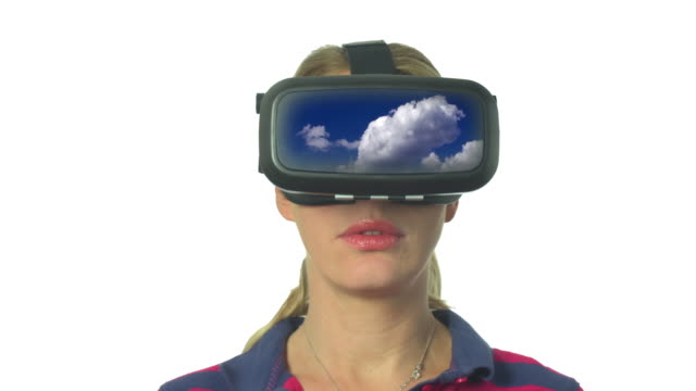 Double Exposure of Woman at CLouds Looking though Virtual Reality Goggles 2 - Brief