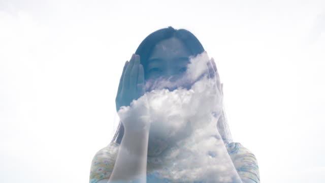 vidéos et rushes de double exposure of woman looking clouds - image projetée