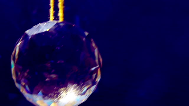 double image of slowly rotating glass crystal pendant - pendant stock videos & royalty-free footage