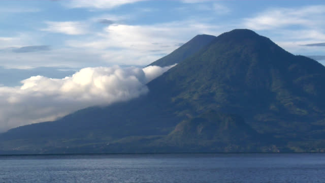 double volcano across lake - guatemala stock videos & royalty-free footage