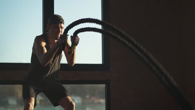 double wave rope exercise in the gym - weight training stock videos & royalty-free footage