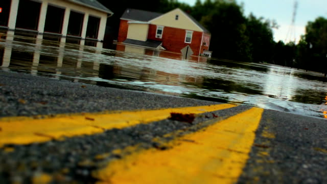 stockvideo's en b-roll-footage met double yellow line leading into flood with tilt-shift - extreem weer