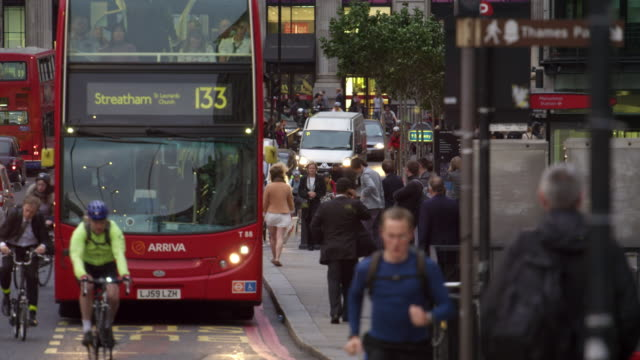 double-decker and cyclists on a busy street - double decker bus stock videos & royalty-free footage