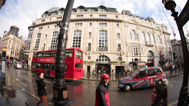A double-decker bus speeds past the Piccadilly Circus Underground Station in London.