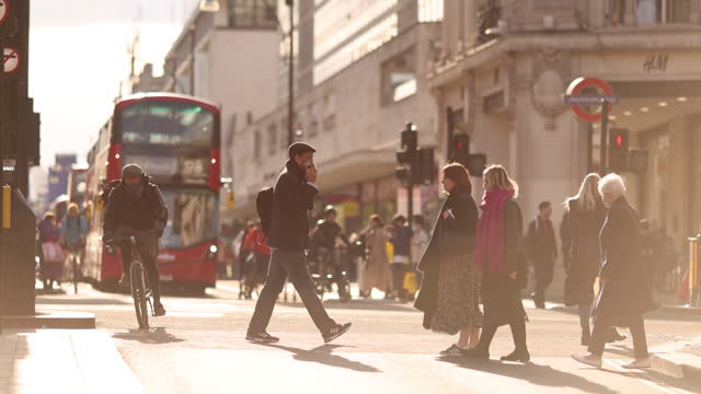 double-decker buses and pedestrians crossing street in london, england, uk, on monday, april 12, 2021. - pedestrian crossing stock videos & royalty-free footage