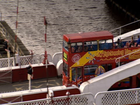 a double-decker tour bus crosses over the swing bridge on the river tyne. - swing bridge stock videos & royalty-free footage