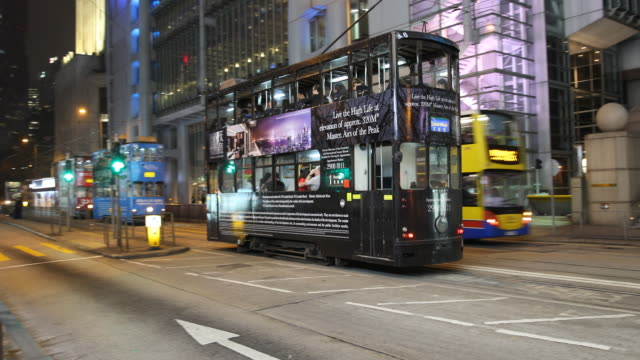doubledecker trams and buses on the street - double decker bus stock videos & royalty-free footage