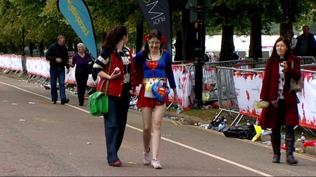doublelung transplant survivor victoria tremlett runs half marathon england london hyde park ext victoria tremlett crossing finish line to complete... - superwoman stock videos and b-roll footage