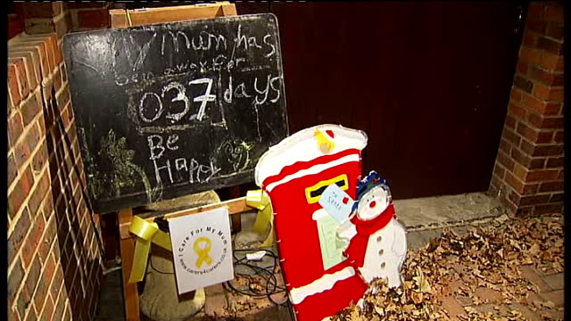 doubts raised over keran henderson baby manslaughter conviction buckinghamshire iver heath blackboard sign and father christmas post box outside... - christmas poster stock videos & royalty-free footage