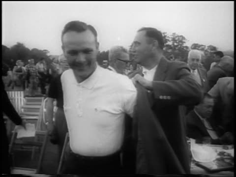 doug ford helping arnold palmer put on winner's jacket after masters tournament - 1958 stock videos & royalty-free footage