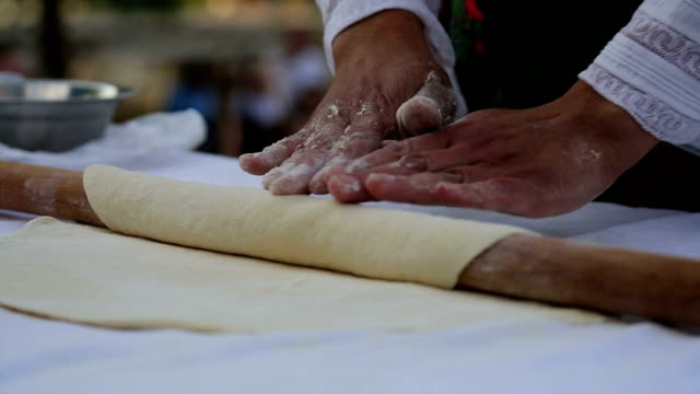 dough and hands close up - rolling pin stock videos & royalty-free footage