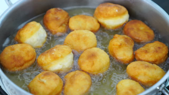doughnuts are fried in oil - making stock videos & royalty-free footage