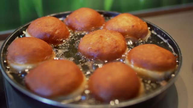 doughnuts are fried in oil - making stock videos and b-roll footage