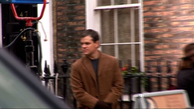 Matt Damon and Clint Eastwood outside Charles Dickens Museum during break in filming