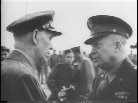 stockvideo's en b-roll-footage met douglas c54 skymaster arrives at airport in france / general george c marshall gets off a plane / marshall shakes hands with general dwight d... - slagfront