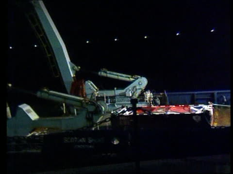 douglas recovery vessel carrying bodies of crewmen of solway harvester along to dock cms side bagpiper playing lament sot la ms container containing... - solway harvester stock videos and b-roll footage