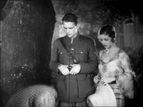 b/w 1931 douglas fairbanks, jr. in uniform + loretta young talking with detective / feature - 1931 stock videos & royalty-free footage