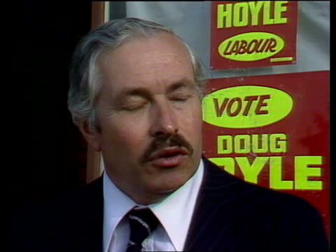Douglas Hoyle profile Warrington SIGN 'Doug Hoyle' on campaign car PAN to Hoyle on doorstep PULL BACK to car 'I'm a man who believes the conference'...