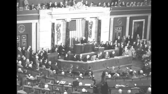 vs douglas macarthur at lectern in background during his appearance before a joint session of the us congress in the house of representatives chamber... - house of representatives stock videos & royalty-free footage