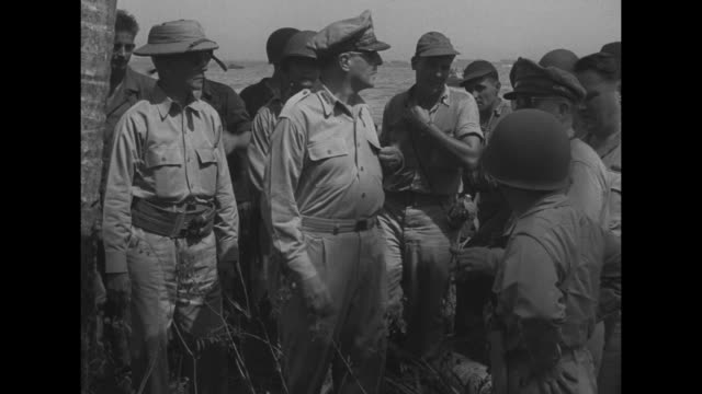 douglas macarthur standing next to philippines president sergio osmena group of officers behind them macarthur steps forward after landing on leyte /... - general macarthur stock videos & royalty-free footage