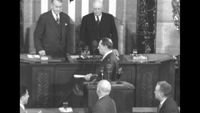 douglas macarthur turns away from lectern in the house chamber shakes hands with speaker of the house sam rayburn and vice president alben barkley as... - sam rayburn video stock e b–roll