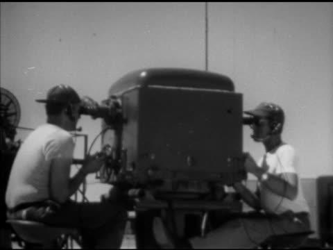 Douglas 'Skyrocket' attached under modified B29 'Superfortress' MS Radar crew at machine on ground 'Skyrocket' launching MS Crew adjusting radar...