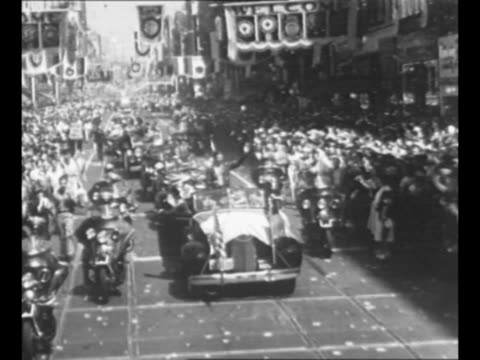 "douglas ""wrong way"" corrigan rides in automobile in los angeles parade with ca governor frank merriam and mayor frank shaw / montage car bearing... - los angeles police department stock videos & royalty-free footage"