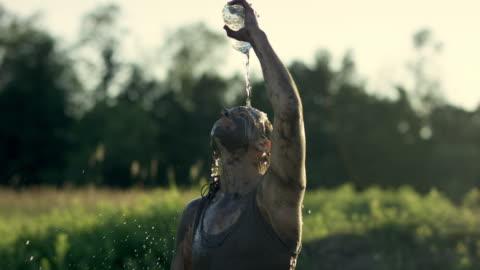 bensinbränning själv med vatten - utmaning bildbanksvideor och videomaterial från bakom kulisserna