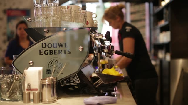 douwe egberts branding sits on display outside a cafe operated by de master blenders 1753 nv in utrecht netherlands on wednesday july 24 a douwe... - utrecht stock videos and b-roll footage