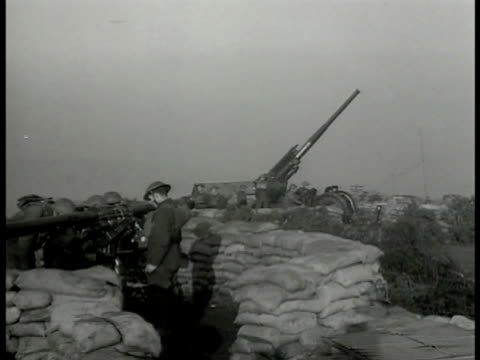 dover cliffs harbor sea bg british soldiers manning antiaircraft cannons british soldier standing looking through w/ binoculars ws antiaircraft guns... - binoculars stock videos & royalty-free footage