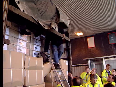 jack straw mp standing at back of lorry as customs officials search for illegal immigrants asylum seeker climbing down from back of truck jack straw... - jack straw stock videos and b-roll footage