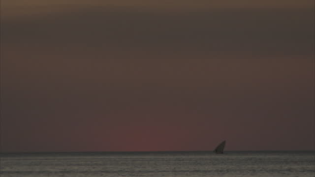Dow boat sails on Indian ocean at sunset, Madagascar