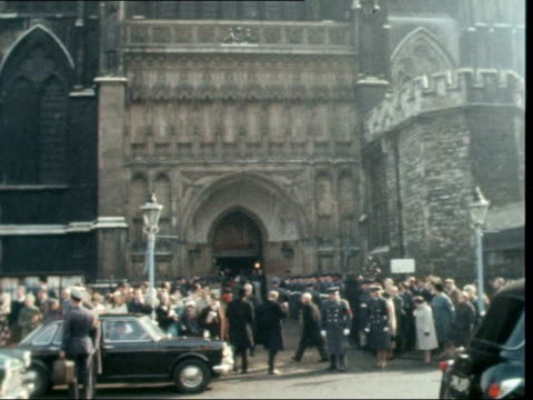 london westminster abbey gv exterior abbey lms entrance and crowds cms standard bearer ms dennis healey defence minister and his wife rl to bv in ms... - denis healey stock videos & royalty-free footage