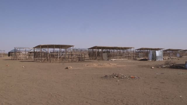 down a sandy track past a dessicated animal carcass lies a cluster of half built huts that ethiopia's government and aid agencies hope will blunt the... - east africa stock videos & royalty-free footage