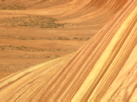 down a streaked sandstone wall - canyon stock-videos und b-roll-filmmaterial