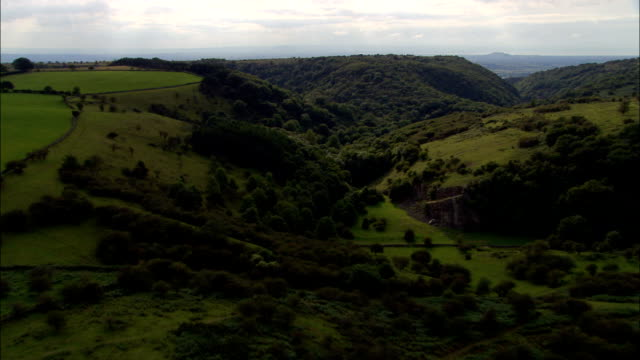 down cheddar gorge  - aerial view - england, somerset, sedgemoor district, united kingdom - cheddar gorge stock videos & royalty-free footage