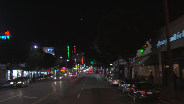 Down Hollywood Boulevard at night, driver's POV