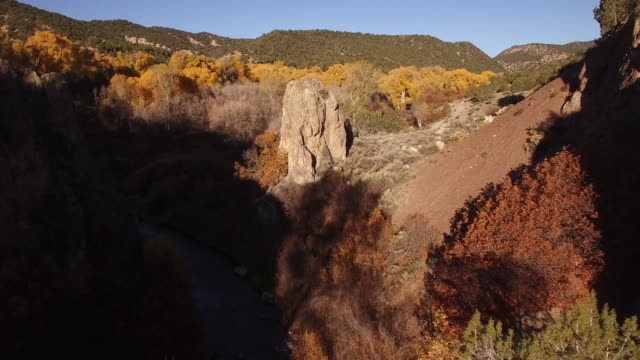 down low fly to rock face orbit,valley, foliage, fall colors, autum, travel, rock spire, beautiful, forest, aerial, 4k, 50s, 6of6, california, stock video sale - drone discoveries llc drone aerial view - world record stock videos and b-roll footage