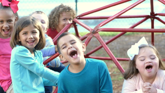 vídeos de stock e filmes b-roll de down syndrome girl and friends on playground, shouting - pessoas com deficiência
