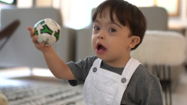 down syndrome son playing at home - learning disability stock videos & royalty-free footage