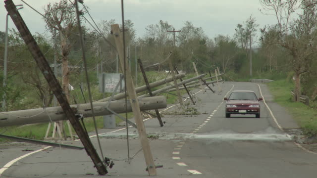 downed power lines lie on road after super typhoon megi or juan, ne luzon, philippines oct 2010 / audio - record breaking stock videos & royalty-free footage