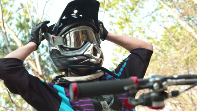hd: downhill biker get ready for a ride - helmet stock videos & royalty-free footage