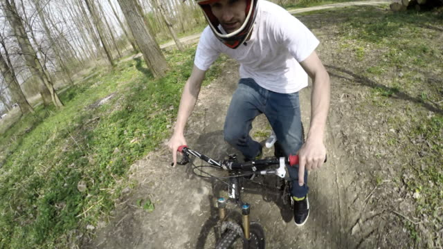 pov downhill biker riding on a dirt road - freestyle bmx stock videos and b-roll footage