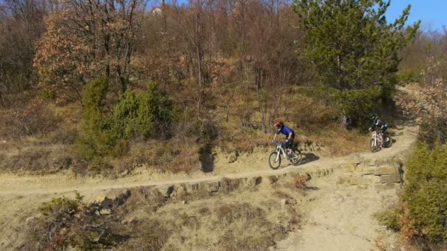 HD: Downhill Bikers Riding Along Trail