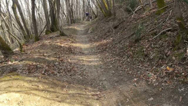 hd: downhill bikers speeding along trail - only teenage boys stock videos & royalty-free footage